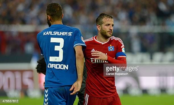 Daniel Gordon of Karlsruhe and Rafael van der Vaart of Hamburg react after the Bundesliga Playoff second leg match between Karlsruher SC and...