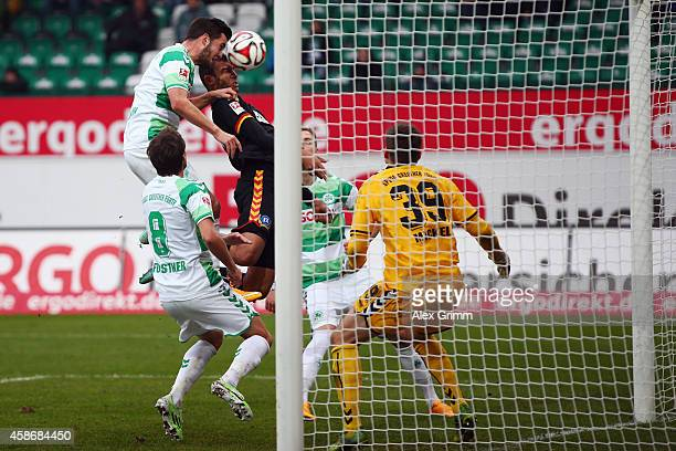 Daniel Gordon of Karlsruhe scores his team's second goal against Niko Giesselmann and goalkeeper Tom Mickel of Greuther Fuerth during the Second...