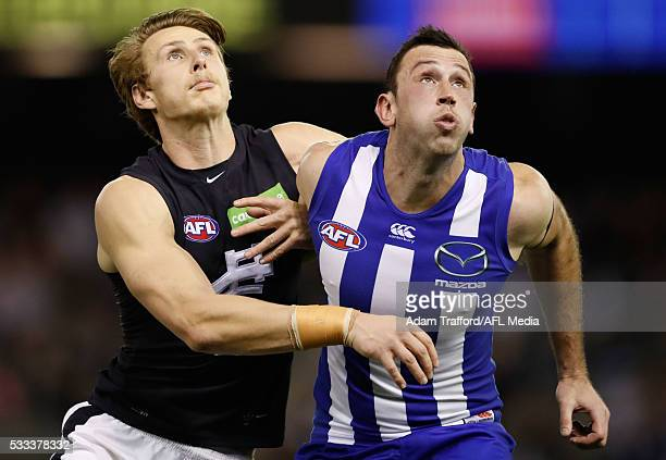 Daniel Gorringe of the Blues and Todd Goldstein of the Kangaroos compete in a ruck contest during the 2016 AFL Round 09 match between the North...