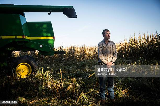 Daniel Graves a 26yearold farmer who would be directly effected by the proposed Keystone XL pipeline stands for a portrait in front of a field of...