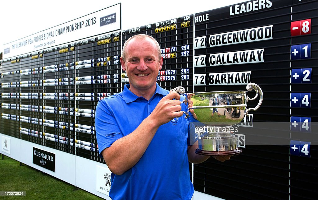 Daniel Greenwood of Forest Pines Golf Club poses for a photograph with the trophy after the final round of the Glenmuir PGA Professional Championship on the Hunting Course at De Vere Slaley Hall on June 14, 2013 in Hexham, England.