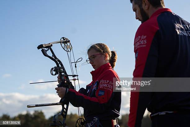 Daniel Grobler a member of the UK's 2016 Invictus Games team trains for archery with his daughter Megan at Whitehall Archers on April 29 2016 in...