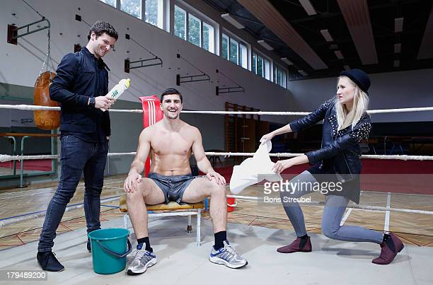 Daniel Grunenberg and Carolin Niemczyk of the pop band Glasperlenspiel pose with WBO Cruiserweight champion Marco Huck of Germany in the ring of his...