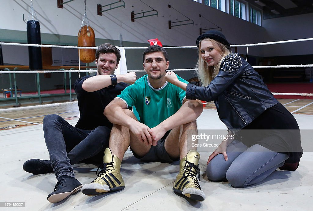 Daniel Grunenberg (L) and Carolin Niemczyk (R) of the pop band Glasperlenspiel pose with WBO Cruiserweight champion <a gi-track='captionPersonalityLinkClicked' href=/galleries/search?phrase=Marco+Huck&family=editorial&specificpeople=2264905 ng-click='$event.stopPropagation()'>Marco Huck</a> (C) of Germany in the ring of his training camp on Usedom on September 4, 2013 in Zinnowitz, Germany.