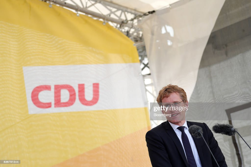 Daniel Guenther, lawmaker of the Christian Democrat Union (CDU) and state premier of Schleswig-Holstein state, speaks during an election campaign stop in Saint Peter-Ording, Germany, on Monday, Aug. 21, 2017. Germany's Chancellor and CDU leader Angela Merkel headed out on the campaign trail last week and quickly faced disruption by anti-immigration demonstrators, a reminder that the refugee crisis that sent her popularity plunging in 2016 remains a residual risk. Photographer: Krisztian Bocsi/Bloomberg via Getty Images