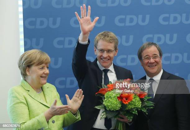 Daniel Guenther lead candidate of the German Christian Democrats in yesterday's state election in SchleswigHolstein waves as he arrives for a meeting...