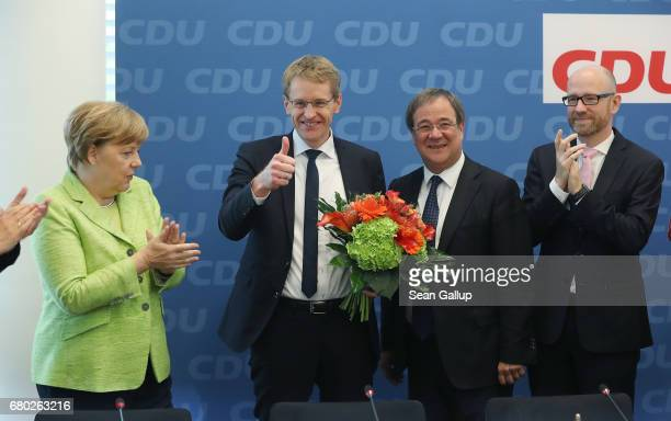 Daniel Guenther lead candidate of the German Christian Democrats in yesterday's state election in SchleswigHolstein shows a thumbs up as he arrives...