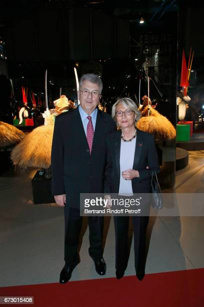 Daniel Guerlain and his wife Florence Guerlain pose in front the works of JeanPaul Goude during the 'Societe des Amis du Musee d'Art Moderne du...