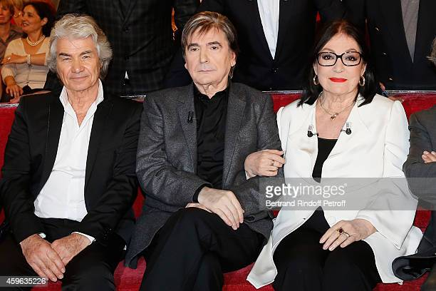 Daniel Guichard Serge Lama and Nana Mouskouri attend the 'Vivement Dimanche' French TV Show at Pavillon Gabriel on November 26 2014 in Paris France