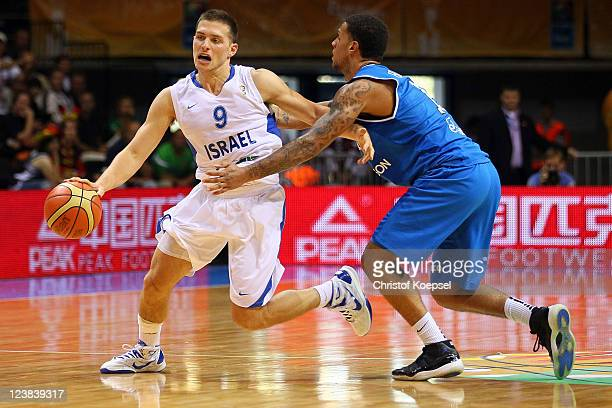 Daniel Hackett of Italy defends against Gal Mekel of Israel during the EuroBasket 2011 first round group B match between Israel and Italy at Siauliai...