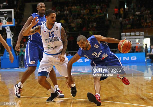 Daniel Hackett of Italy defends against Tony Parker of France during the EuroBasket 2011 first round group B match between Italy and France at...
