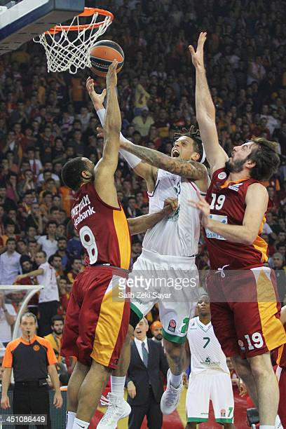 Daniel Hackett of Montepaschi Siena competes with Furkan Aldemir and Malik Hairston of Galatasaray Liv Hospital during the 20132014 Turkish Airlines...