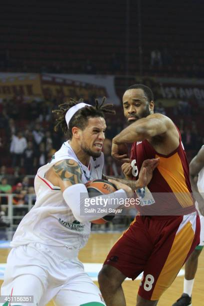 Daniel Hackett of Montepaschi Siena competes with Malik Hairston of Galatasaray Liv Hospital during the 20132014 Turkish Airlines Euroleague Regular...
