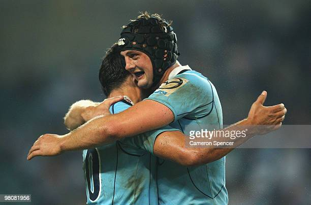 Daniel Halangahu and Dean Mumm of the Waratahs celebrate winning the round seven Super 14 match between the Waratahs and the Blues at Sydney Football...