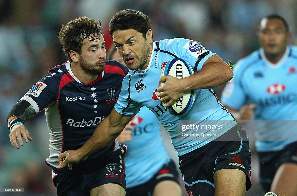 <a gi-track='captionPersonalityLinkClicked' href=/galleries/search?phrase=Daniel+Halangahu&family=editorial&specificpeople=599230 ng-click='$event.stopPropagation()'>Daniel Halangahu</a> of the Waratahs is tackled by <a gi-track='captionPersonalityLinkClicked' href=/galleries/search?phrase=Danny+Cipriani&family=editorial&specificpeople=688774 ng-click='$event.stopPropagation()'>Danny Cipriani</a> of the Rebels during the round nine Super Rugby match between the Waratahs and the Rebels at Allianz Stadium on April 21, 2012 in Sydney, Australia.