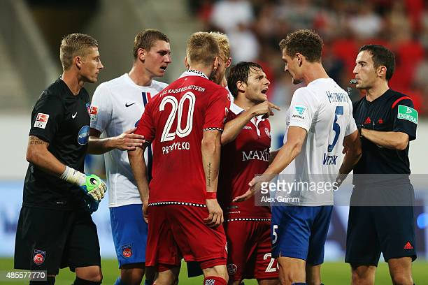Daniel Halfar of Kaiserslautern Mathias Wittek of Heidenheim and team mates argue during the Second Bundesliga match between 1 FC Heidenheim and 1 FC...