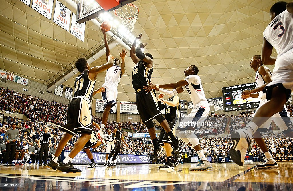 Daniel Hamilton of the Connecticut Huskies drives to the basket for a layup in front of Brandon Goodwin and Staphon Blair of the Central Florida...