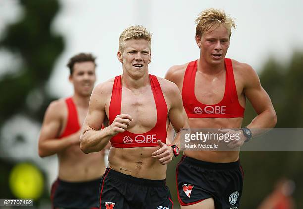 Daniel Hannebery and Isaac Heeney run during a Sydney Swans AFL preseason training session at Lakeside Oval on December 5 2016 in Sydney Australia