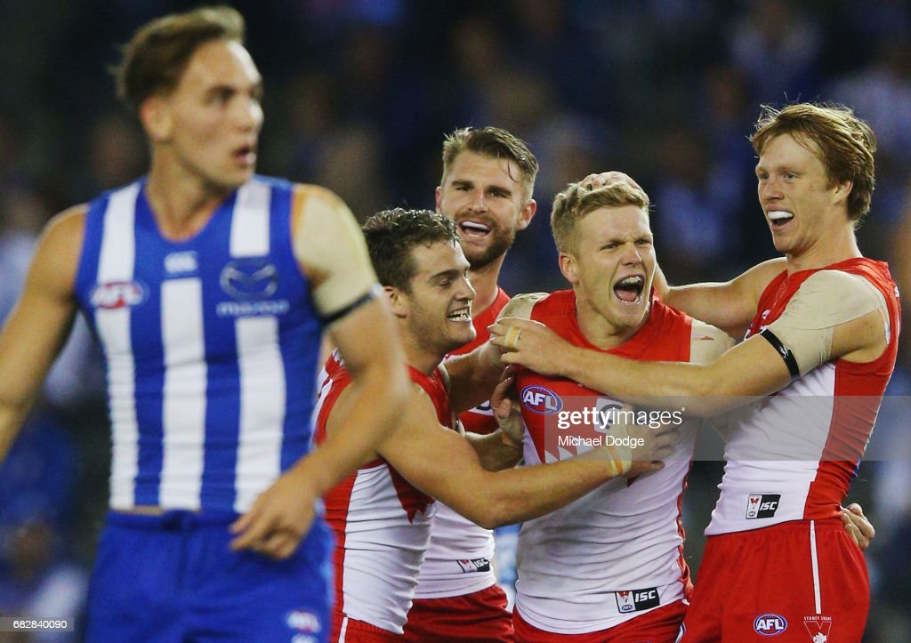 Daniel Hannebery of the Swans celebrates a goal with Callum Mills (R) during the round eight AFL match between the North Melbourne Kangaroos and the Sydney Swans at Etihad Stadium on May 14, 2017 in Melbourne, Australia.
