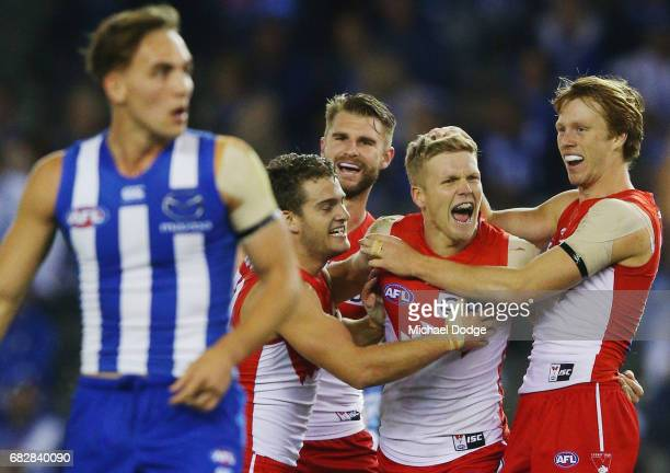Daniel Hannebery of the Swans celebrates a goal with Callum Mills during the round eight AFL match between the North Melbourne Kangaroos and the...