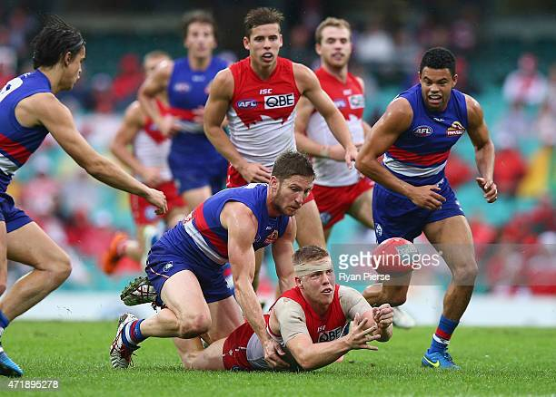 Daniel Hannebery of the Swans handballs out of the pack during the round five AFL match between the Sydney Swans and the Western Bulldogs at SCG on...