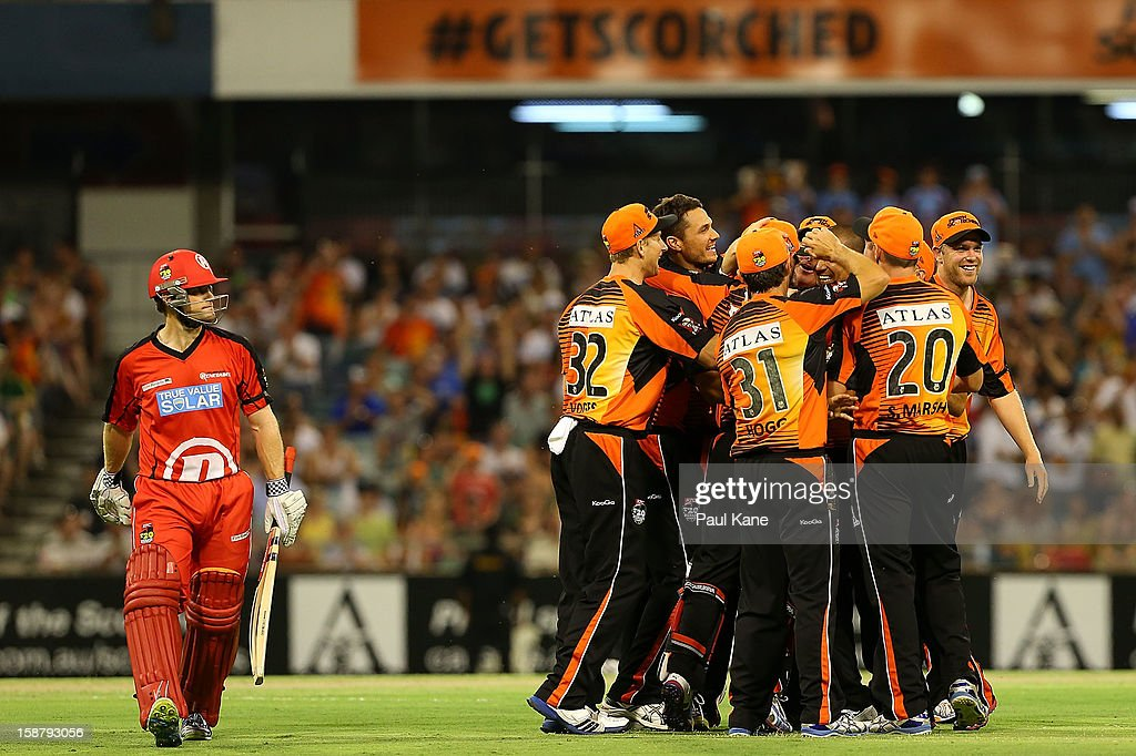 <a gi-track='captionPersonalityLinkClicked' href=/galleries/search?phrase=Daniel+Harris+-+Cricket+Player&family=editorial&specificpeople=15327310 ng-click='$event.stopPropagation()'>Daniel Harris</a> of the Renegades walks back to the rooms after being dismissed by <a gi-track='captionPersonalityLinkClicked' href=/galleries/search?phrase=Alfonso+Thomas&family=editorial&specificpeople=2644222 ng-click='$event.stopPropagation()'>Alfonso Thomas</a> of the Scorchers during the Big Bash League match between the Perth Scorchers and the Melbourne Renegads at WACA on December 29, 2012 in Perth, Australia.