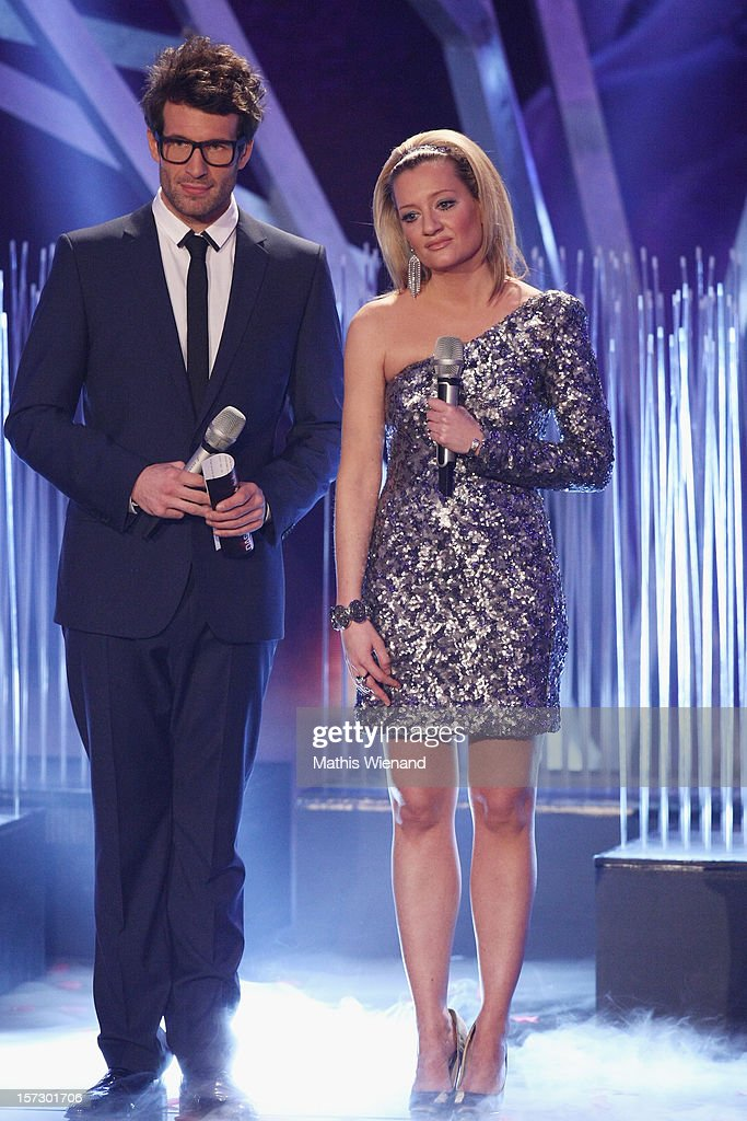Daniel Hartwich and Juliette Schoppmann attend the First Live Show of 'Das Supertalent' on December 1, 2012 in Cologne, Germany.