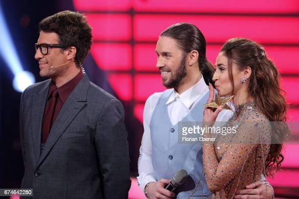 Daniel Hartwich Gil Ofarim and Ekaterina Leonova perform on stage during the 6th show of the tenth season of the television competition 'Let's Dance'...