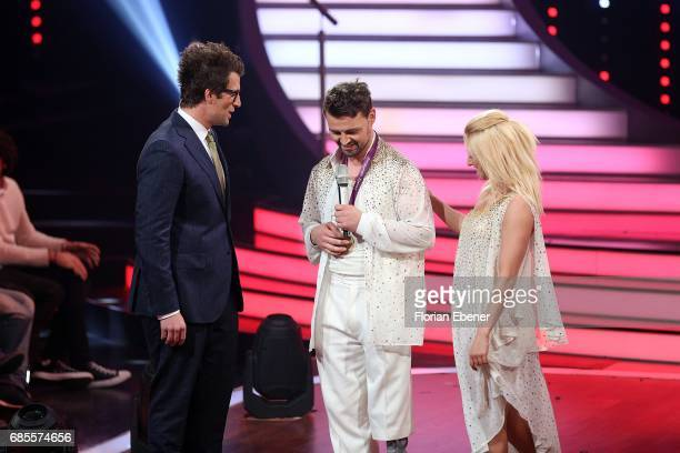 Daniel Hartwich Heinrich Popow and Kathrin Menzinger perform on stage during the 9th show of the tenth season of the television competition 'Let's...