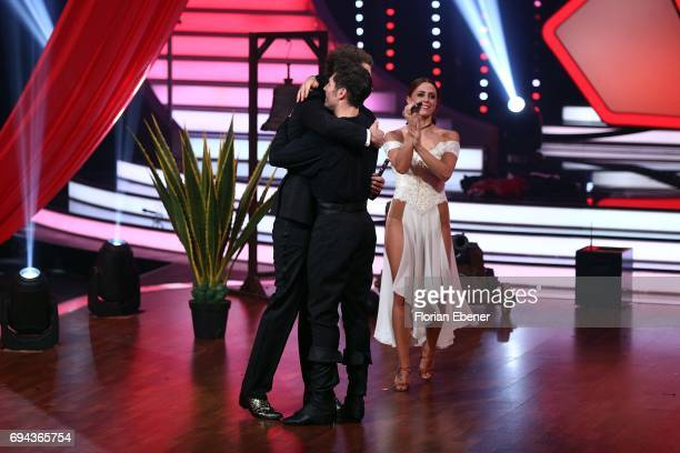 Daniel Hartwich Vanessa Mai and Christian Polanc perform on stage during the final show of the tenth season of the television competition 'Let's...