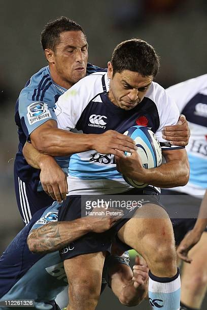 Daniel Helangahu of the Waratahs charges forward away from Stephen Brett of the Blues during the round nine Super Rugby match between the Blues and...