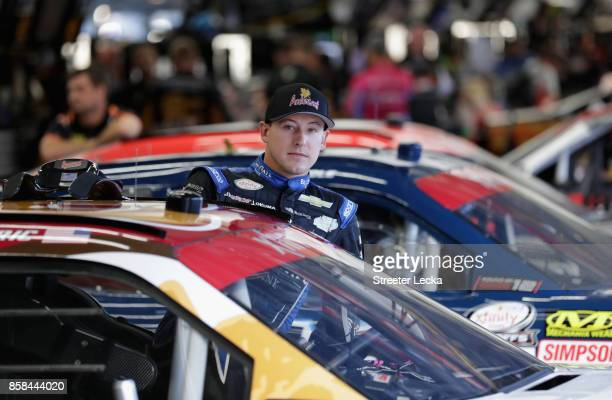 Daniel Hemric driver of the Anderson's Maple Syrup Chevrolet climbs into his car during practice for the NASCAR XFINITY Series Drive for the Cure 300...