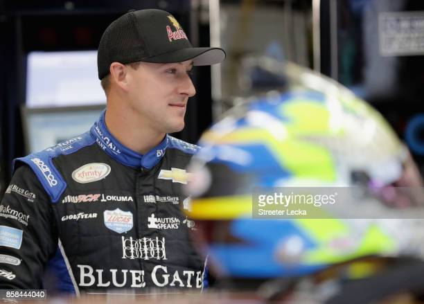 Daniel Hemric driver of the Anderson's Maple Syrup Chevrolet stands in the garage area during practice for the NASCAR XFINITY Series Drive for the...