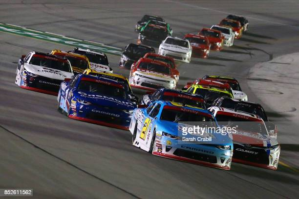 Daniel Hemric driver of the Blue Gate Bank Chevrolet and Matt Tifft driver of the VstMyrtleBchcom/RnJnShp/SrfcSnscrn Toyota lead a pack of cars...