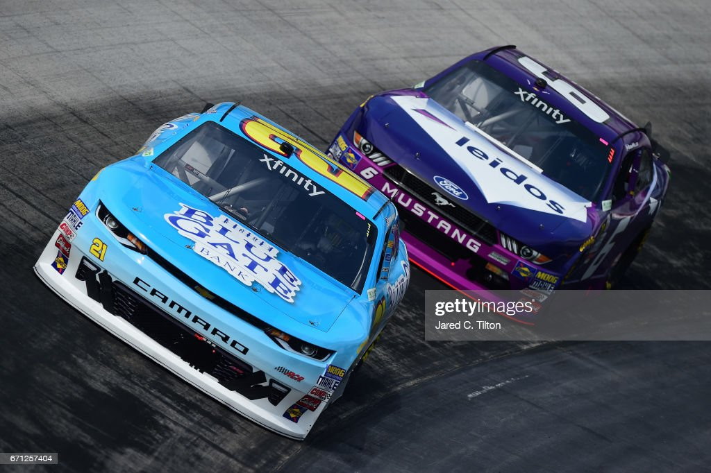 Daniel Hemric, driver of the #21 Blue Gate Bank Chevrolet, drives in front of Darrell Wallace Jr., driver of the #6 Leidos Ford, during practice for the NASCAR XFINITY Series Fitzgerald Glider Kits 300 at Bristol Motor Speedway on April 21, 2017 in Bristol, Tennessee.