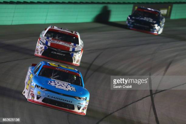 Daniel Hemric driver of the Blue Gate Bank Chevrolet leads Matt Tifft driver of the VstMyrtleBchcom/RnJnShp/SrfcSnscrn Toyota and Brennan Poole...