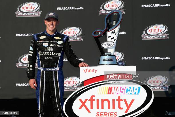 Daniel Hemric driver of the Blue Gate Bank Chevrolet poses for a photo opportunity following the NASCAR XFINITY Series TheHousecom 300 at Chicagoland...