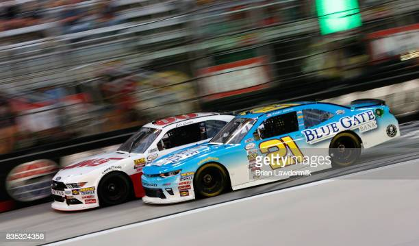 Daniel Hemric driver of the Blue Gate Bank Chevrolet races Cole Custer driver of the Haas/One Cure Ford during the NASCAR XFINITY Series Food City...
