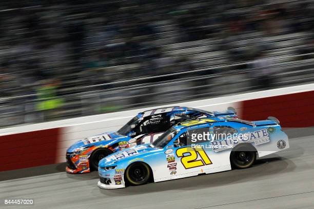 Daniel Hemric driver of the Blue Gate Bank Chevrolet races Kyle Busch driver of the NOS Energy Drink Toyota during the NASCAR XFINITY Series...