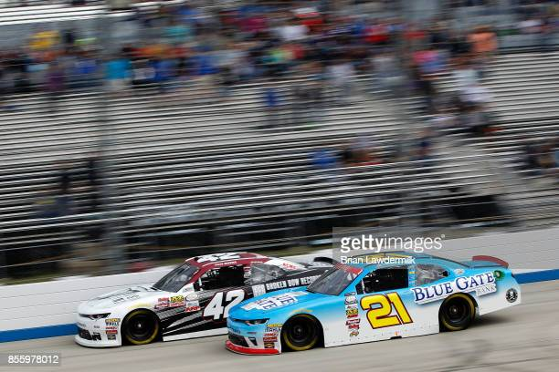 Daniel Hemric driver of the Blue Gate Bank Chevrolet races Tyler Reddick driver of the BBR/Dustin Lynch Chevrolet during the NASCAR XFINITY Series...