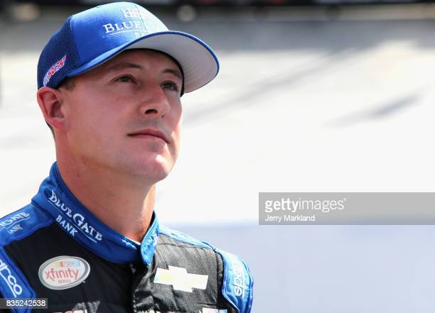 Daniel Hemric driver of the Blue Gate Bank Chevrolet stands by his car during qualifying for the NASCAR XFINITY Series Food City 300 at Bristol Motor...
