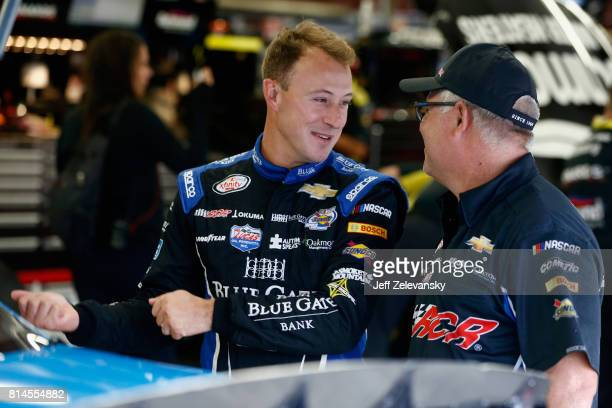 Daniel Hemric driver of the Blue Gate Bank Chevrolet stands in the garage area during practice for the NASCAR XFINITY Series Overton's 200 at New...