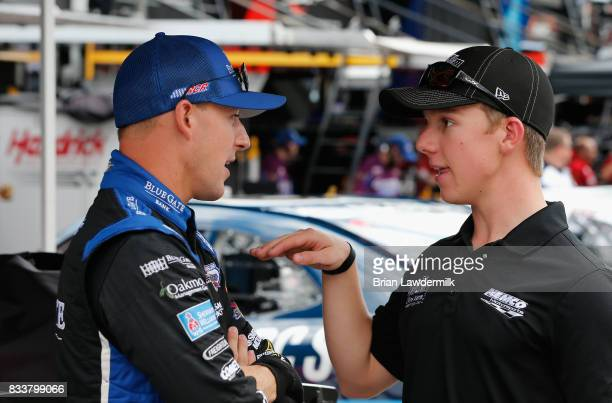 Daniel Hemric driver of the Blue Gate Bank Chevrolet talks to John Hunter Nemechek during practice for the NASCAR Xfinity Series Food City 300 at...
