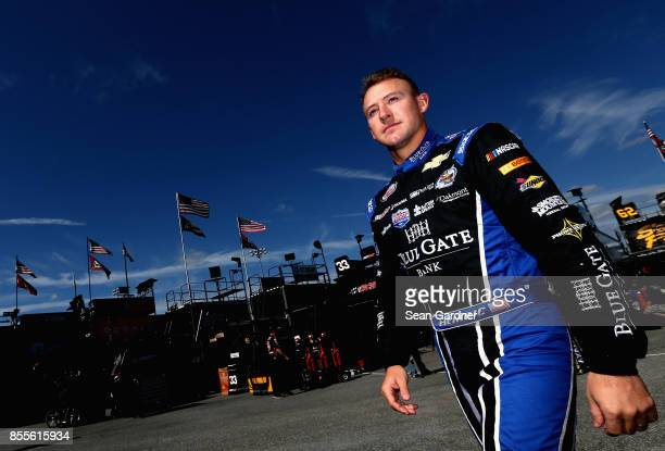 Daniel Hemric driver of the Blue Gate Bank Chevrolet walks through the garage area during practice for the NASCAR XFINITY Series 'Use Your Melon...