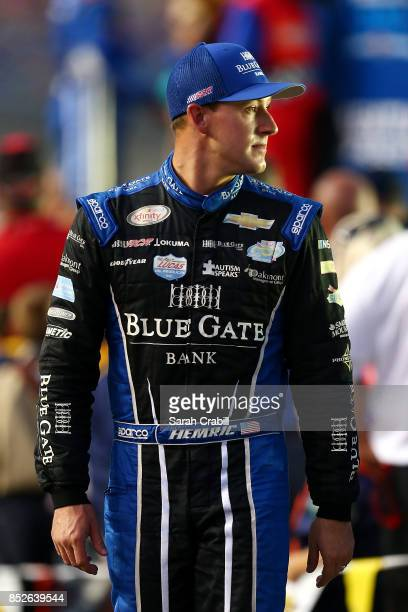 Daniel Hemric driver of the Blue Gate Bank Chevrolet walks to his car before the NASCAR XFINITY Series VisitMyrtleBeachcom 300 at Kentucky Speedway...