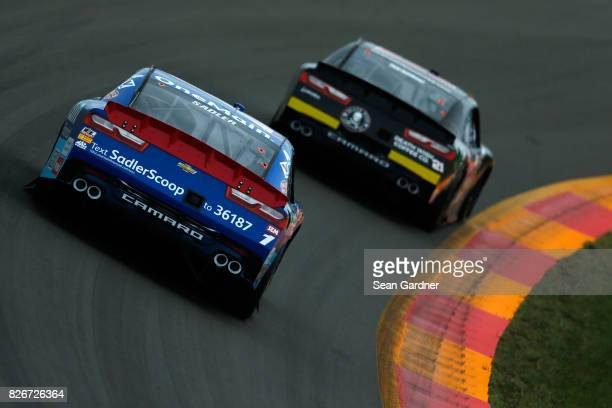 Daniel Hemric driver of the Death Wish Coffee Chevrolet leads Elliott Sadler driver of the OneMain Financial Chevrolet during the NASCAR XFINITY...