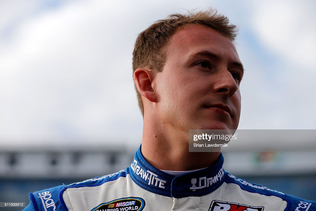Daniel Hemric, driver of the #19 DrawTite Ford, stands on the grid during qualifying for the NASCAR Camping World Truck Series NextEra Energy Resources 250 at Daytona International Speedway on February 19, 2016 in Daytona Beach, Florida.