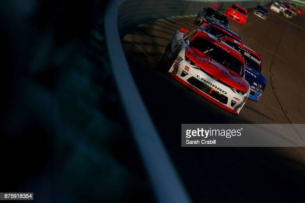 Daniel Hemric driver of the Poppy Bank Chevrolet leads a pack of cars during the NASCAR XFINITY Series Championship Ford EcoBoost 300 at...
