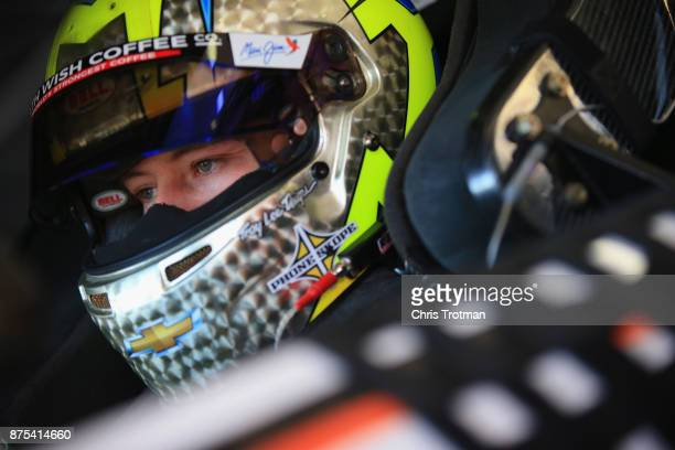 Daniel Hemric driver of the Poppy Bank Chevrolet sits in his car in the garage area during practice for the NASCAR XFINITY Series Championship Ford...