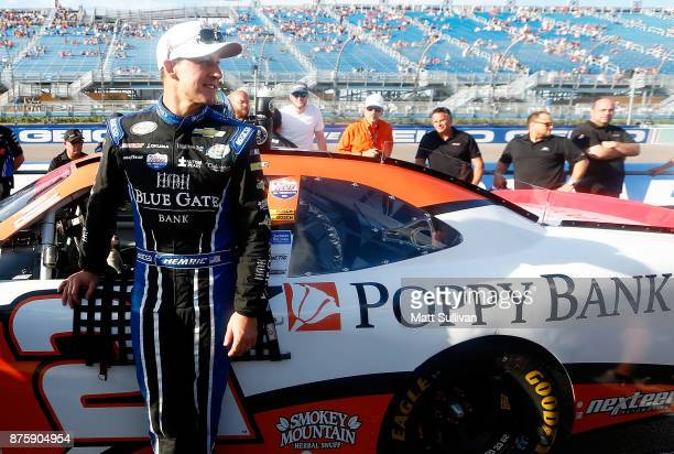 Daniel Hemric driver of the Poppy Bank Chevrolet sog during prerace ceremonies for the NASCAR XFINITY Series Championship Ford EcoBoost 300 at...
